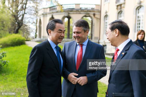 German Foreign Minister and Vice Chancellor Sigmar Gabriel and Wang Yi Foreign Minister of China meet next to Chinas Ambassador in Berlin Shi Mingde...