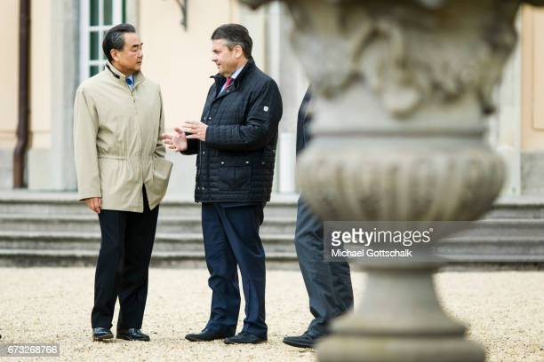 German Foreign Minister and Vice Chancellor Sigmar Gabriel and Wang Yi Foreign Minister of China go for a walk in the garden of Villa Borsig during...