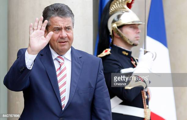 German Foreign Minister and Vice Chancellor Sigmar Gabriel gestures as he arrives at the Elysee Presidential Palace on August 30 2017 in Paris France...