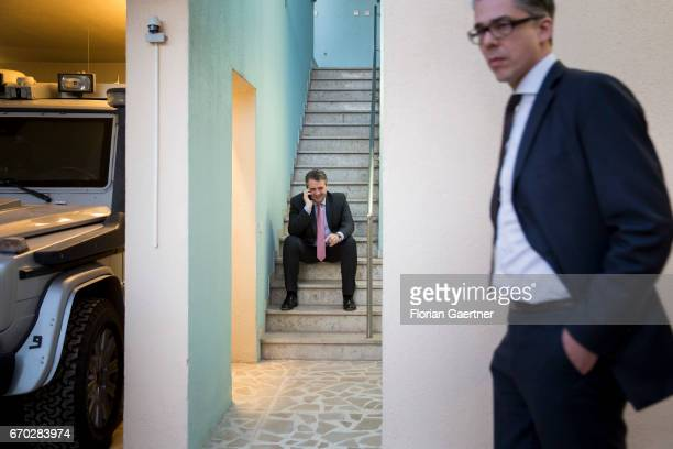 German Foreign Minister and Vice Chancellor Sigmar Gabriel makes a call next to the Leader of the Minister Office Ricklef Beutin at the German...
