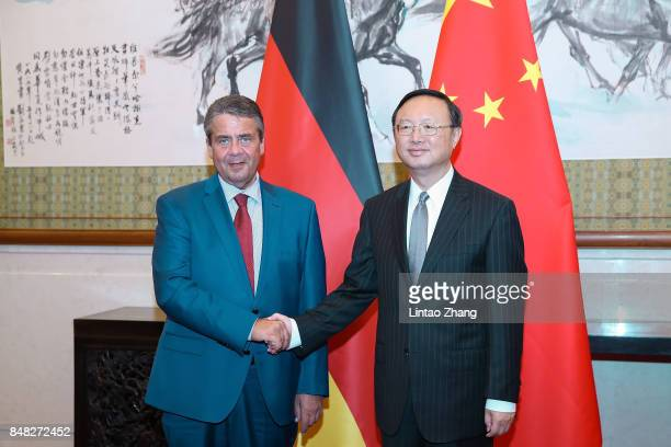 German Foreign Minister and Vice Chancellor Sigmar Gabriel shakes hands with Chinese State Councilor Yang Jiechi before their meeting at Diaoyutai...
