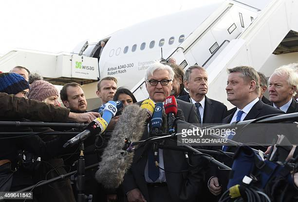 German Foreign Minister FrankWalter Steinmeier addresses the press next to German Health Minister Hermann Groehe after visiting the Airbus A340300...
