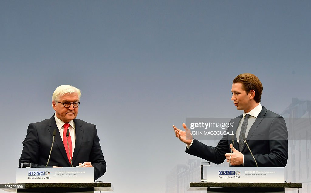 German Foreign Minister Frank-Walter Steinmeier (L) and Austrian Foreign Minister Sebastian Kurz attend a press conference after closing session of the foreign ministers' meeting of the Organisation for Security and Cooperation in Europe (OSCE) in Hamburg, northern Germany, on December 9, 2016. / AFP / John MACDOUGALL