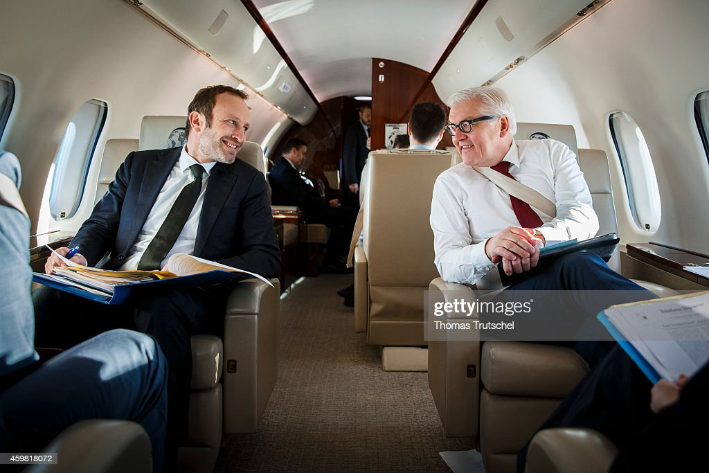 German Foreign Minister Frank-Walter Steinmeier (R), and Denmark's Foreign Minister Martin Lidegaard sits in an Global 5000 Airplane of German Air Force to travel from Copenhagen to Brussels on December 02, 2014 in Copenhagen, Denmark. Both ministers will attend the North Atlantic Treaty Organization (NATO) Foreign Affairs Ministers meeting at NATO headquarters.