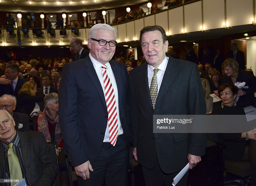 German Foreign Minister Frank-Walter Steinmeier (R) and former German chancellor Gerhard Schroeder at a celebration hosted by Die Zeit newspaper on the occasion of Schmidt's 95th birthday at the Thalia theater on January 19, 2014 in Hamburg, Germany. Schmidt, a Social Democrat (SPD), was Chancellor of West Germany from 1974 to 1982.
