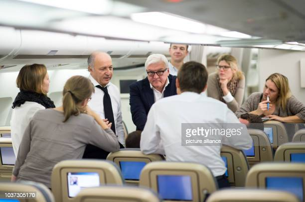 German Foreign Minister FrankWalter Steinmeier and French Foreign Minister Laurent Fabius on a German Air Force plane travelling to Abuja Nigeria 27...
