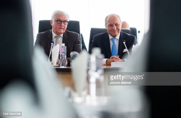 German Foreign Minister FrankWalter Steinmeier and French Foreign Minister Laurent Fabius with representatives of the Independent National Electoral...
