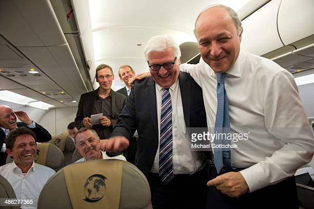 German Foreign Minister FrankWalter Steinmeier and French Foreign Minister Laurent Fabius on board a German Air Force plane during the flight from...