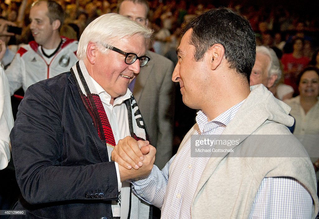 German Foreign Minister Frank-Walter Steinmeier and German Greens Party (Buendnis 90/Die Gruenen) co-Chairman Cem Oezdemir attend the screening of the final of the FIFA World Cup Germany - Argentina at the House of World Cultures (Haus der Kulturen der Welt) on July 13, 2014 in Berlin, Germany.