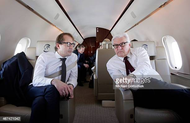 German Foreign Minister FrankWalter Steinmeier and German Transport Minister Alexander Dobrindt sit in a plane of german government during their...