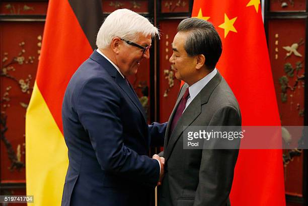 German Foreign Minister FrankWalter Steinmeier and his Chinese counterpart Wang Yi shake hands during the second round of the ChinaGermany strategic...