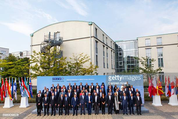 German Foreign Minister FrankWalter Steinmeier and his counterparts pose for a family photo at a conference of OSCE members states on September 1...