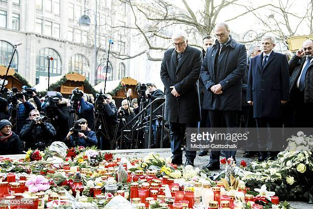 German Foreign Minister FrankWalter Steinmeier and Italian Minister of Foreign Affairs Angelino Alfano visit a makeshift memorial of flowers and...