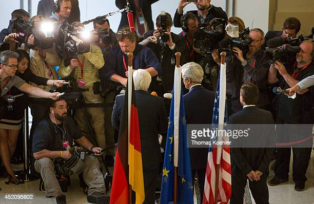 German Foreign Minister FrankWalter Steinmeier and US Secretary of State John Kerry speak to the press on July 13 2014 in Vienna Austria Vienna is...