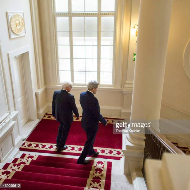 German Foreign Minister FrankWalter Steinmeier and US Secretary of State John Kerry walk to a press conference on July 13 2014 in Vienna Austria...