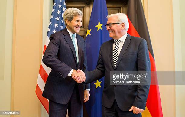German Foreign Minister Frank-Walter Steinmeier and US Secretary of State John Kerry meet in Villa Borsig for a bilateral talk on September 20, 2015...