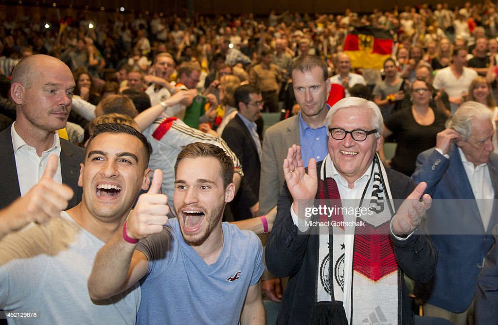 German Foreign Minister Frank-Walter Steinmeier (R) attends the screening of the final of the FIFA World Cup Germany - Argentina at the House of World Cultures (Haus der Kulturen der Welt) on July 13, 2014 in Berlin, Germany.