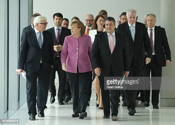 German Foreign Minister FrankWalter Steinmeier Chancellor and German Christian Democrats Chairwoman Angela Merkel German Social Democrats Chairman...