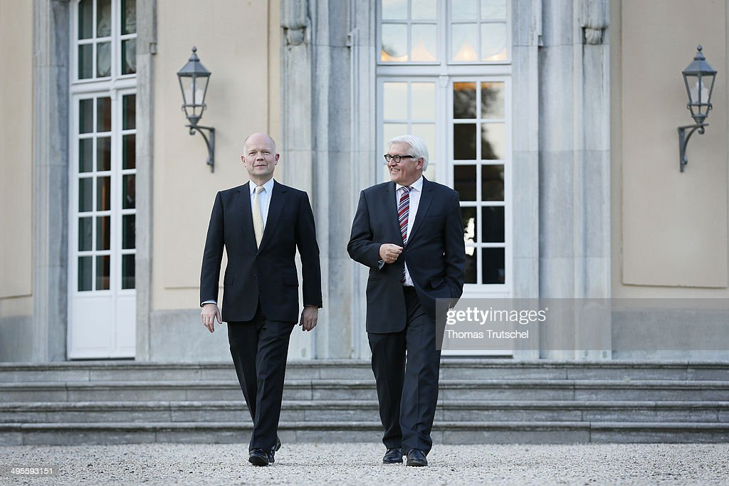 German Foreign Minister Frank-Walter Steinmeier (R) chats with United Kingdom's Foreign Minister William Hague during a walk trough the garden Villa Borsig, the guesthouse of German Foreign Office on June 04, 2014 in Berlin, Germany.