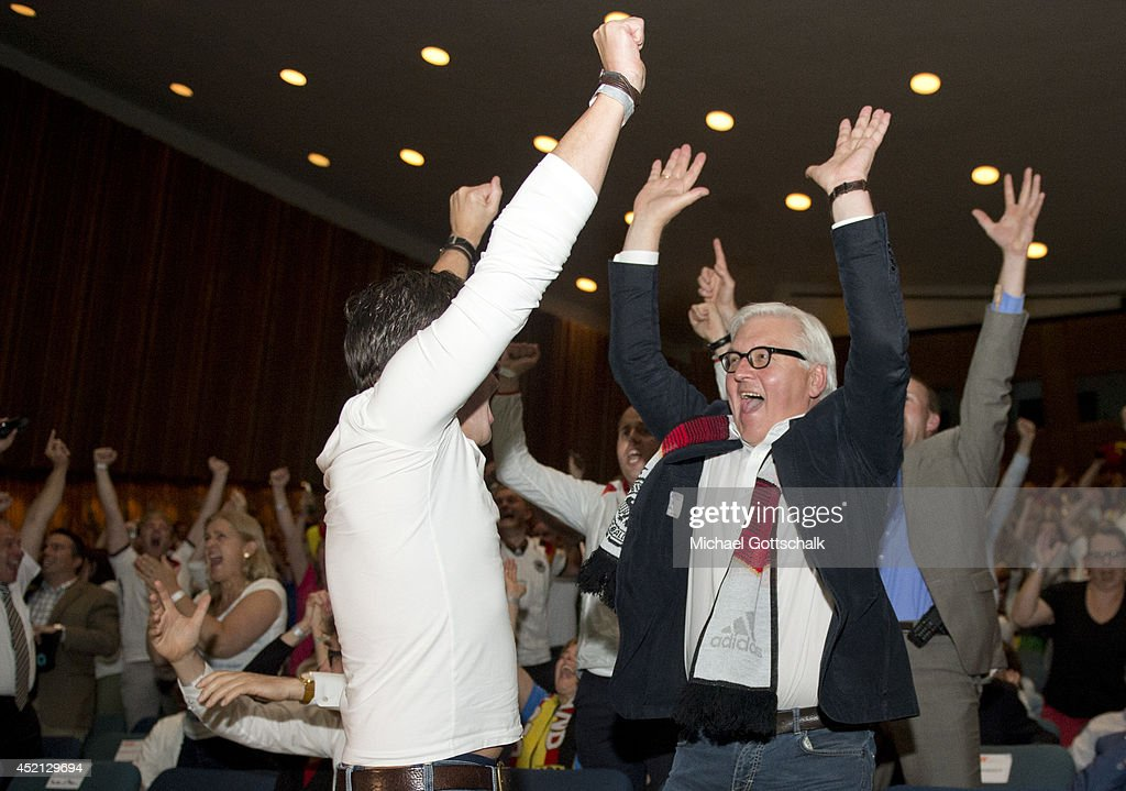 German Foreign Minister Frank-Walter Steinmeier cheers during the screening of the final of the FIFA World Cup Germany - Argentina at the House of World Cultures (Haus der Kulturen der Welt) on July 13, 2014 in Berlin, Germany.