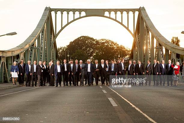 German Foreign Minister FrankWalter Steinmeier cross together with counterparts the Glienicker Bridge in the evening of a conference of OSCE members...