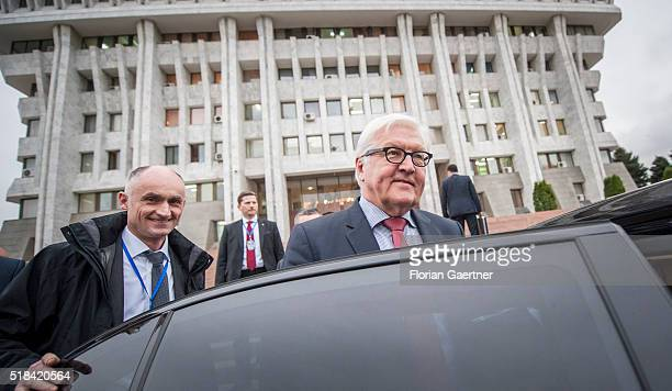 German Foreign Minister FrankWalter Steinmeier enter the car after his meeting with kyrgyz parlamentarians on March 31 2016 in Bishkek Kyrgyzstan...