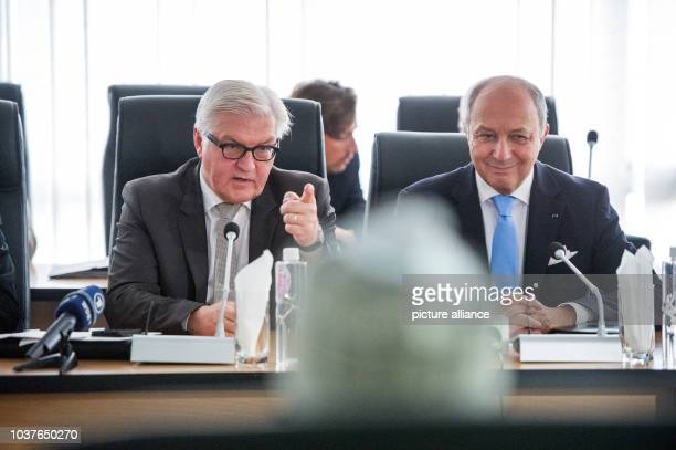 German Foreign Minister FrankWalter Steinmeier French Foreign Minister Laurent Fabius and the Chairman of the Independent National Electoral...