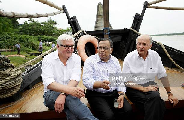 German Foreign Minister FrankWalter Steinmeier French Foreign Minister Laurent Fabius and Foreign Minister of Bangladesh Abul Hasan Mahmud Ali on a...