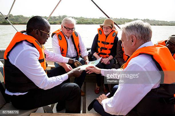German Foreign Minister FrankWalter Steinmeier French Foreign Minister Marc Ayrault and Ibrahim Yacouba Foreign Minister of Niger travel on a boat on...