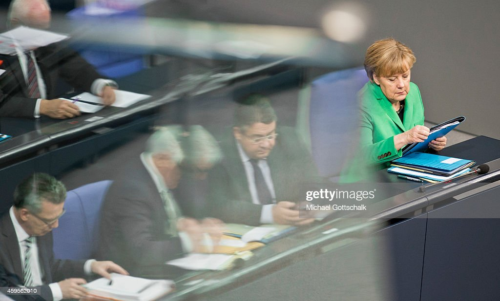 German Foreign Minister Frank-Walter Steinmeier, German Economy Minister and Vice Chancellor Sigmar Gabriel and German Chancellor Angela Merkel (L-R) attend the budget debate in German Bundestag on November 25, 2014 in Berlin, Germany. German Finance Minister Wolfgang Schaeuble wants EU to have budget veto powers over national budgets that breach Eurozone criteria.