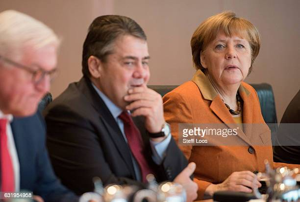 German Foreign Minister FrankWalter Steinmeier German Economy Minister Sigmar Gabriel and German Chancellor Angela Merkel attend the weekly...