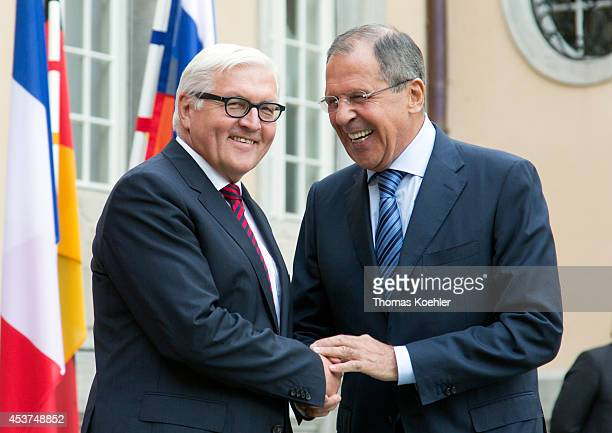 German Foreign Minister FrankWalter Steinmeier greets Russian Foreign Minister Sergey Lavrov prior to talks with French Foreign Minister Laurent...