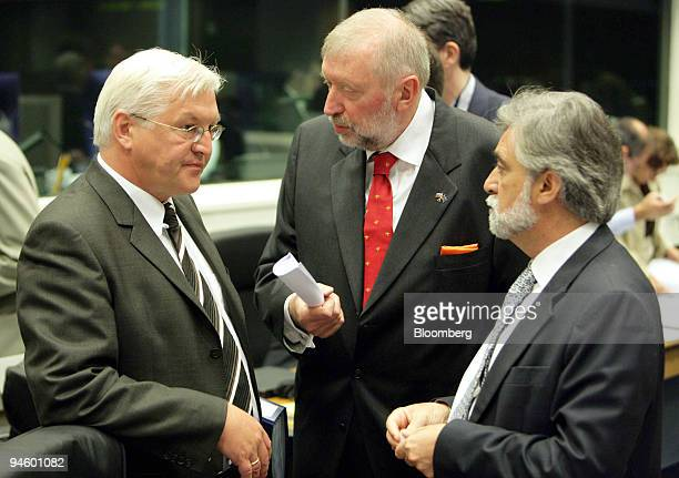 German Foreign Minister, Frank-Walter Steinmeier, left, speaks with Slovenian Foreign Minister, Dimitrij Rupel and Portuguese Foreign Minister Luis...