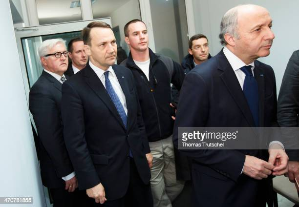 German Foreign Minister Frank-Walter Steinmeier, Polish Foreign Minister Radoslaw Sikorski, and French Foreign Minister Laurent Fabius arrive to...