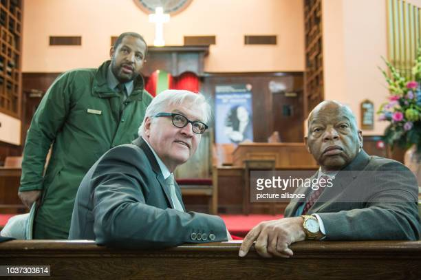 German Foreign Minister Frank-Walter Steinmeier sits on a church bench next to a ranger of the Nation Park Service and congressman John Lewis in the...