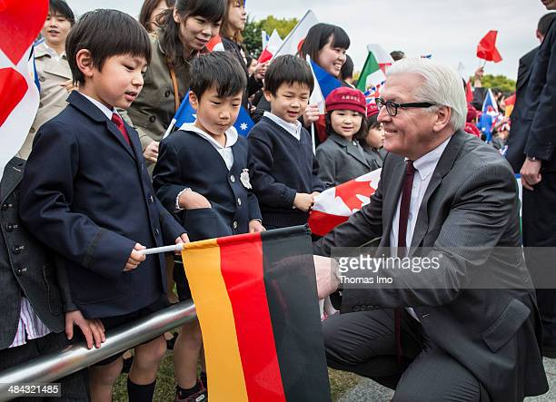 German Foreign Minister FrankWalter Steinmeier talks to children during his visit to the monument for the 1945 atomic bomb victims at the Hiroshima...