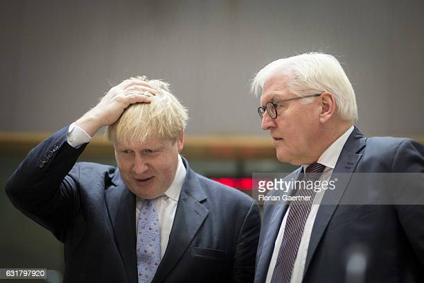 German Foreign Minister Frank-Walter Steinmeier talks with the Foreign Minister of Great Britain Boris Johnson on January 16, 2017 in Brussels,...