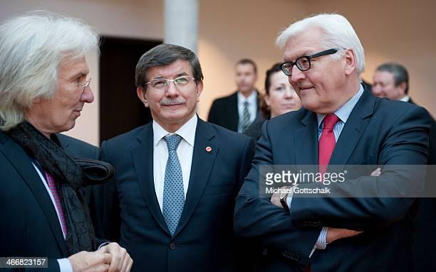 German Foreign Minister FrankWalter Steinmeier talks with Turkish Embassador to Germany Hueseyin Avni Karslioglu and Foreign Minister Ahmet Davutoglu...