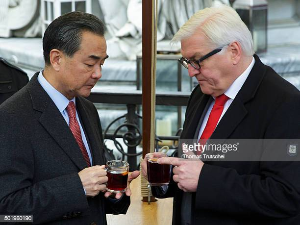 German Foreign Minister FrankWalter Steinmeier visits the annual Christmas market at Gendarmenmarkt together with China's Foreign Minister Wang Yi on...
