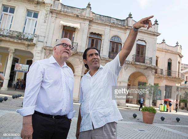 German Foreign Minister FrankWalter Steinmeier visits the city centre of Havana accompanied by tour guide Michael Gonzales Rodrigez on July 16 2015...