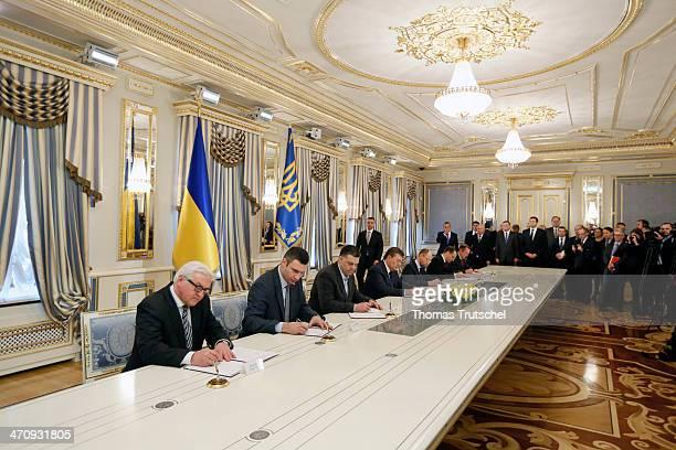 German Foreign Minister FrankWalter Steinmeier Vitali Klitschko leader of Ukraine's UDAR opposition party leader of AllUkrainian Union 'Svoboda' Olej...