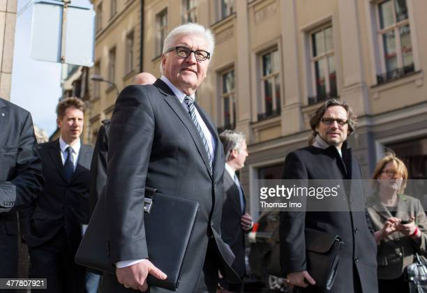 German Foreign Minister FrankWalter Steinmeier walks to a meeting with Latvia's President Andris Berzins on March 11 2014 in Riga Latvia Steinmeier...