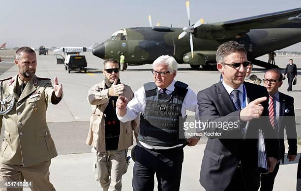 German Foreign Minister FrankWalter Steinmeier walks with German ambassador Markus Potzel as he arrives at the airport on September 06 2014 in Kabul...