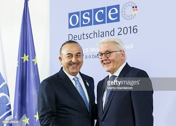 German Foreign Minister FrankWalter Steinmeier welcomes Turkish Foreign Minister Mevluet Cavusoglu as he arrives for the summit of OCSE members...