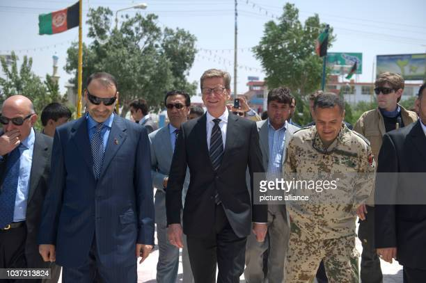 German Foreign Minister Guido Westerwelle and Afghan General Atta Mohammed Noor walk on their way to the Blue Mosque in MasariScharif Afghanistan 9...