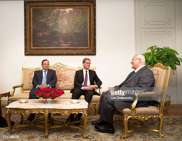 German Foreign Minister Guido Westerwelle and Egypt Foreign Minister Nabil Fahmy and Egypt Vice President Mohamed El-Baradei look on during a meeting...