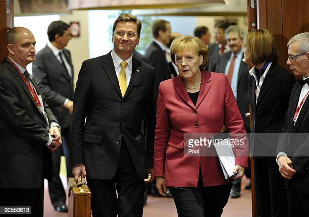 German Foreign Minister Guido Westerwelle and German Chancellor Angela Merkel attend the European Union Summit at the EU headquarters on October 30...