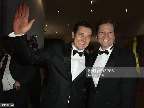 German Foreign Minister Guido Westerwelle and Michael Mronz attend the annual press ball 'Bundespresseball' at the Intercontinental Hotel in Berlin...