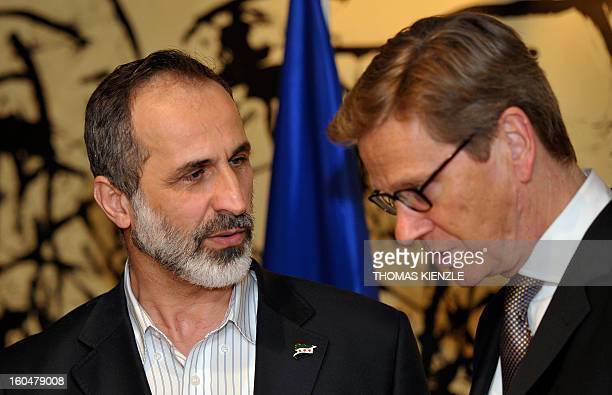 German Foreign Minister Guido Westerwelle and Moaz AlKhabib President of the National Coalition of Syrian Revolutionary and Opposition Forces meet...