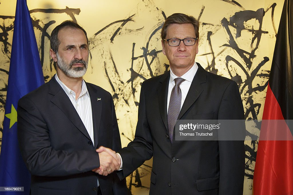 German Foreign Minister Guido Westerwelle (R) and Sheikh Ahmed Moaz Al-Khatib, President of the National Coalition for Opposition Forces and the Syrian Revolution, shake hands during a bilateral meeting on day 1 of the 49th Munich Security Conference, at Hotel Bayerischer Hof on February 1, 2013 in Munich, Germany. The Munich Security Conference brings together senior figures from around the world to engage in an intensive debate on current and future security challenges and remains the most important independent forum for the exchange of views by international security policy decision-makers.